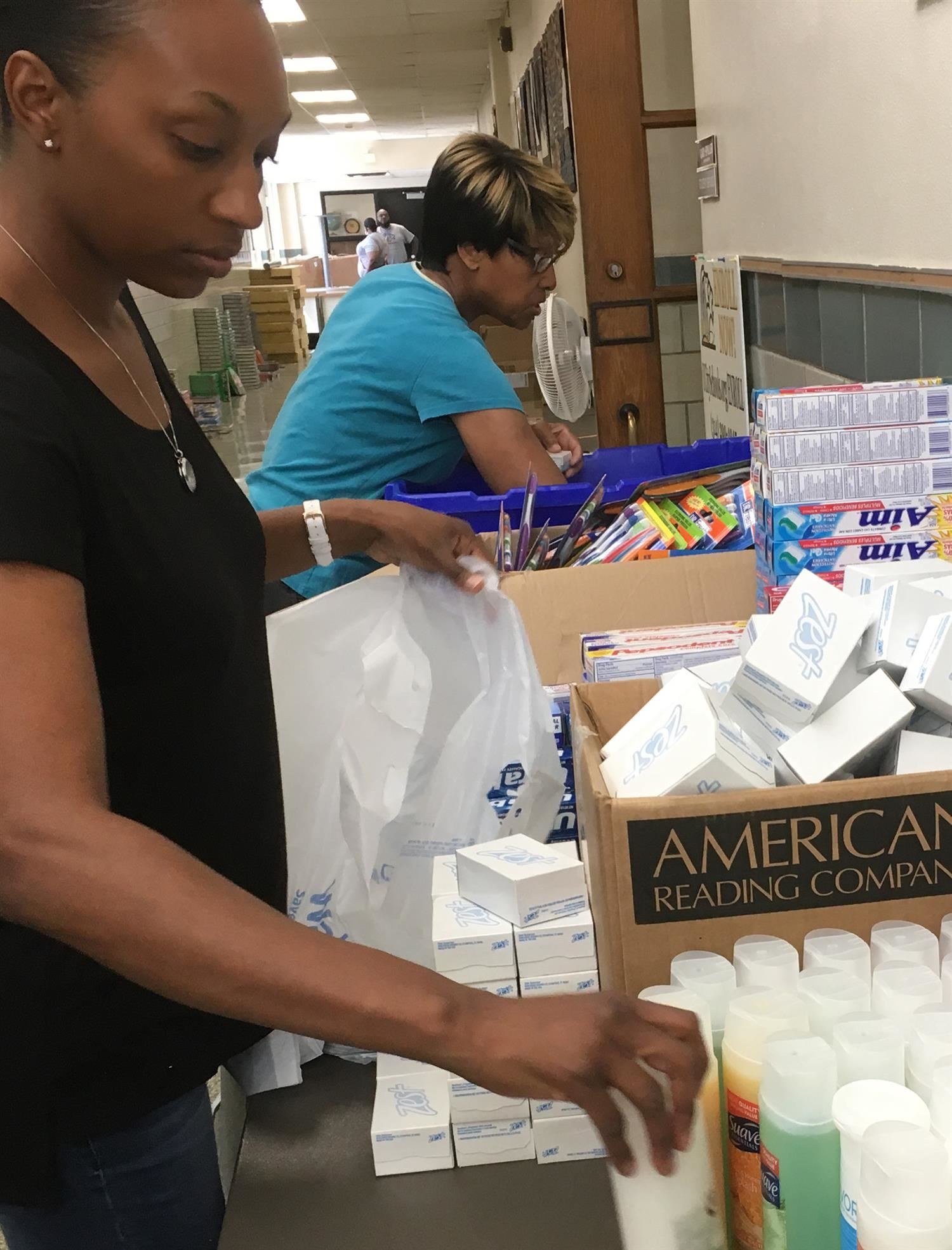 packing personal supplies for families in need