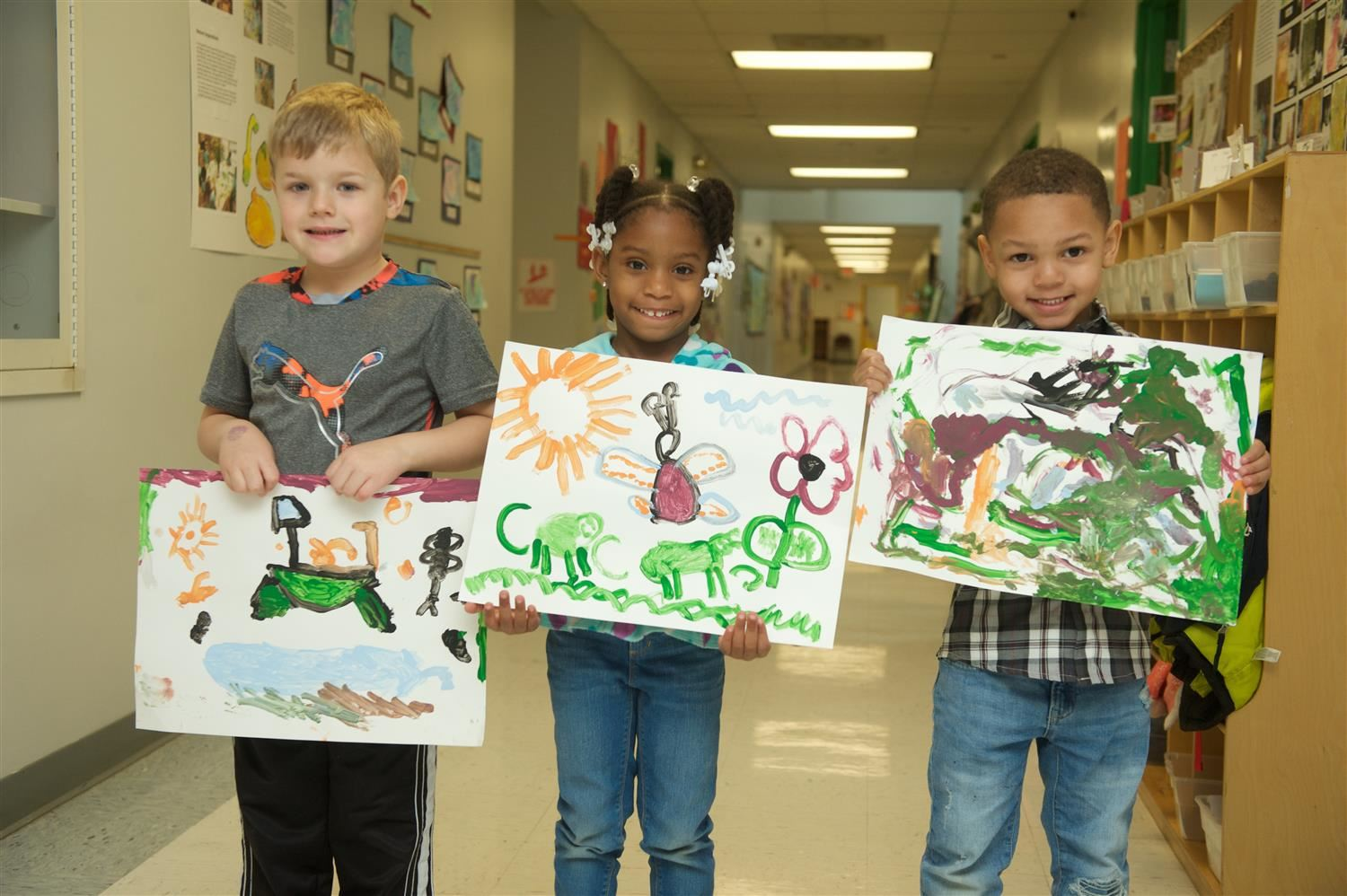 students showing their artwork