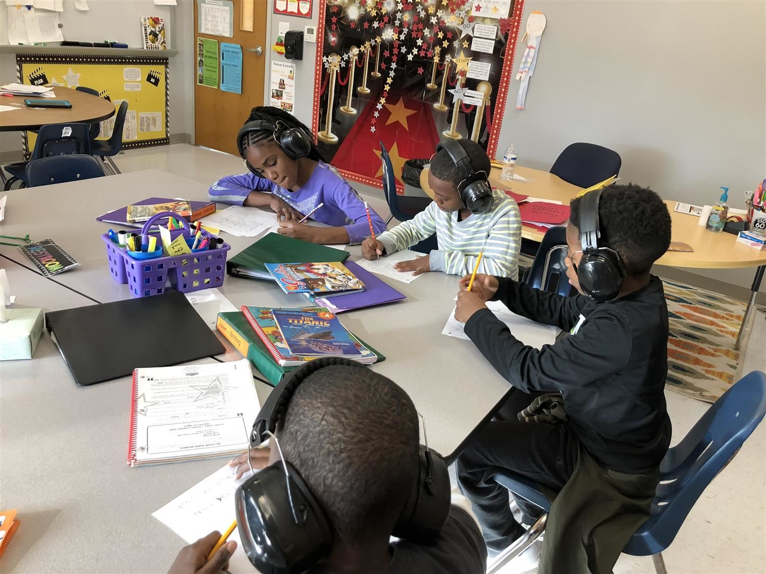 students study with earmuffs